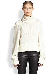 Everyone needs a chunky sweater, and this is modern cool. Helmut Lang Austere Oversized Ribbed Wool Turtleneck Sweater