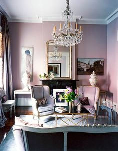 the chairs & chandelier & the paintings & wall color