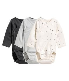 Check this out! CONSCIOUS. Long-sleeved wrapover bodysuits in soft jersey made from organic cotton. Snap fasteners at one side and at gusset. - Visit hm.com to see more.