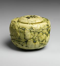 "Covered Bowl with Virginia Creeper. The glaze on the bowl is one of Tiffany's earliest. Called ""Old Ivory,"" it darkens when it pools in the interstices of the design, accentuating the sculptural relief."