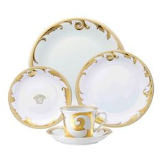 Versace - Versace Arabesque Gold 5pc Place Setting - Versace Arabesque Gold 5pc Place Setting   ***   Since the late 1970s the Versace brand has been synonymous with Italian luxury. For over 30 years their products have been known for uncompromising design as well as their sensual style and peerless craftsmanship. Many of our Versace Italian dinnerware sets are adorned with the famous medusa logo and offer a touch of Italian fashion and luxury to any meal. Shop our selection today to find a…