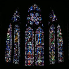 13th Century stained-glass windows above the choir, representing Our Lady, the Christ, the apostles, archbishops et bishops.