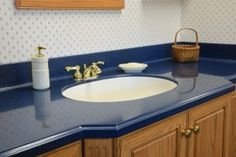 Residential Blue Corian Solid Countertops With Undermount Sink And Nice Backsplash Idea . Cost Of Countertops, Wooden Countertops, Wooden Cabinets, Blue Kitchen Designs, Blue Kitchen Decor, Bathroom Designs, Bathroom Ideas, Kitchen Ideas, Bathroom Worktops