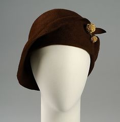 Brown wool cloche with two gold knot buttons, ca. 1925. American. Made by Grace M. Cunningham.