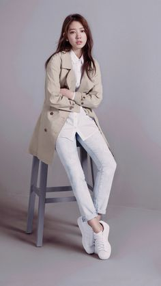 nice trench, light blue jeans, and sneakers