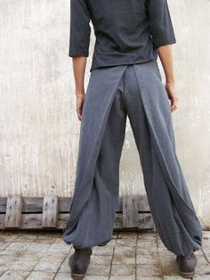 Our Best Seller!! 4 Way Women Wrap Pants - Versatile pants that can be changed by playing with the wings and Velcro closure. Details: * Balloon shaped the bottom of trousers. (elastic strap) * Zipper at the back. * Wings can be attached to the front, to the back or one wing is attached to the