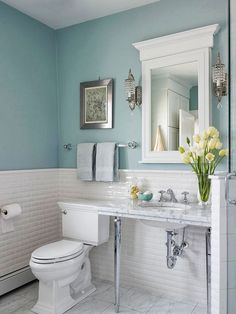 Incorporate brighter and lighter colors into your bathroom to liven it up, like this sky blue bathroom... Changing Seasons: Sunny & Sophisticated Spring Bathroom Decor from Bathroom Bliss by Rotator Rod