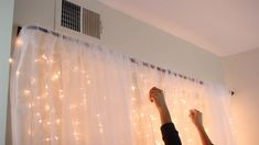 How to Make a Light Up Headboard. Headboards can be expensive and take up a lot of space. If you are looking for a stylish, cost-effective way to accentuate your bed, then a light up curtain headboard may be the perfect choice. Curtain Behind Headboard, Diy Headboard With Lights, Wall Behind Bed, Bed Wall, Bed Lights, Curtain Lights, Diy Curtains, Hanging Curtains, Bedroom Lighting