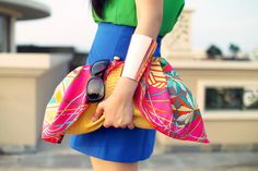 Colourful clutches the size of large bags.