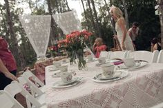 Children's Tea Party.  Lace Curtains hung from trees with twine.