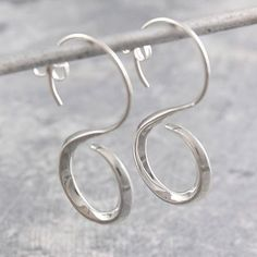These quirky earrings are sterling silver and easy to wear, creating a snakelike flowing style that can be worn everyday for a splash of individuality! #Otisjaxon #Jewellery