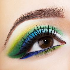 A fabulous look using #greenmakeup as well as blues and yellows.