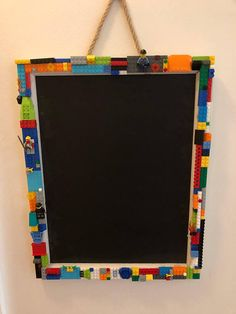 This is a hanging chalk board decorated with genuine LEGO bricks and mini figures. It measures 16x20 inches.