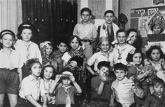 Hanukkah celebration at an orphanage for Jewish children in Lodz run by the Koordynacja (Coordination Committee). Poland. 1948-1949.