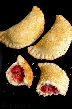 Strawberry Rhubarb Empanadas:  15-18 medium or 25-30 small sweet empanada discs made from basic sweet pastry dough     3 cups chopped rhubarb     3 cups chopped strawberries     1 cup sugar     2 tbs orange juice     1 tbs cornstarch     1 egg, yolk and white separated and lightly whisked     ½ cup demerara sugar
