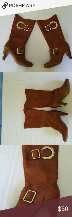 NWOT BCBG Girls Cognac Boots with gold buckles NWOT Beautiful BCBG Knee high boits with gorgeous gold buckle detais. These beautiful boots have leather uppers and a rubber bottom to help you tread the snow this winter! A warm cognac color. BCBGirls Shoes