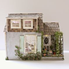 "This is my little ""Summer House"" dollhouse.  It oozes Cape Cod vintage style with the ease of summertime furnishings.       This dollhouse i..."