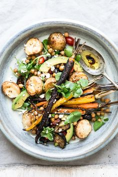 2 eggplants 10 baby potatoes 1 bunch baby carrots 1 can chickpeas, drained 1 tbls harissa spice 1 tables ground cumin olive oil 100g feta cheese watercress ½ avocado salt and pepper