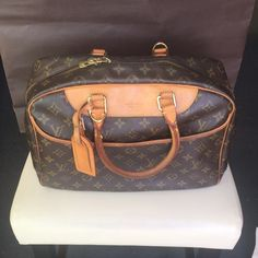 """Authentic Louis Vuitton Deauville Bag Size : 14""""x 11"""" x 6"""" Handle drop 6""""  Condition:  very good pre-owned condition ! Clean exterior.  some scratches on gold tone hardware   Exterior canvas corners  and piping are in good shape,   Anyhow the color of trim  and handles is turning  patina   some  marks on trim leather.    Please see the pictures.  Please contact me if you need more pictures  comes with Name Tag and Authentication certificate! Louis Vuitton Bags"""
