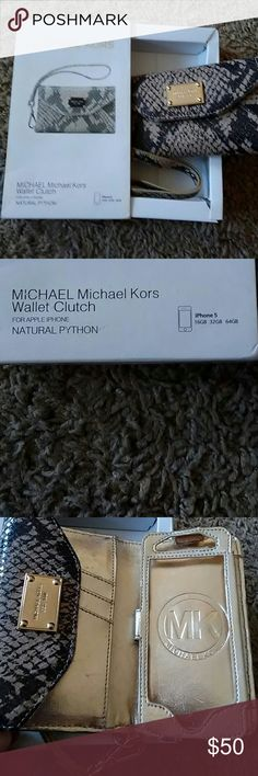 Michael Kors wallet / phone carrier Beautiful natural python wristlet will hold an iPhone 5. Gently used but still in good condition Michaels Kors Accessories Phone Cases