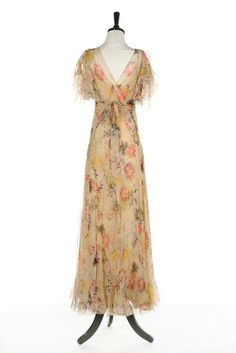 Archive List - Kerry Taylor AuctionsA printed chiffon garden party gown, early 1930s, of pale primrose chiffon with flounced sleeves and ties across the bodice, matching slip, bust 86cm, 34in; together with a late 1930s Peter Jones brocaded rayon hostess gown, bust 97cm, 38in (3) - See more at: http://kerrytaylorauctions.com/archive-list/?id=89&sts=archive&paging=4#sthash.eEmEvixE.dpuf