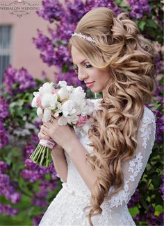 wavy long wedding hairstyle with pearl crown