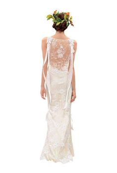 Open Back Wedding Dresses From Fall 2013 | Wedding Dresses | Brides.com |   Ivory lace, beaded gown with blush silk lining and ribbons, $8,750, by Claire Pettibone  See more Claire Pettibone wedding dresses.