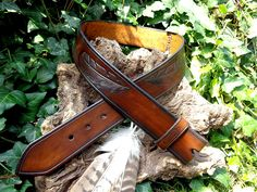 My own new belt, inspired by feathers. Made this out of heavy duty veg tanned leather #belt #feathers #