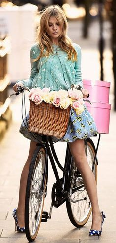 A cute girl, are more cute, when she's riding a bike