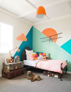 Or how about only designing a corner of his room like this.. You can paint the geometric shapes yourself and find decals of a plane or whatever to add onto it.