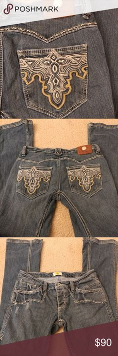 """🚨SALE🚨 Antik Bootcut Jeans These bootcut jeans are Antik Denim and are very unique. They have super long legs and beautiful ivory stitchinf throughout with intricate embroidered back pockets. There are 3 buttons in the front but 2 are hidden, so only 1 shows. Size: 29  Length: 40"""" Inseam: 32""""  99% cotton. 1% spandex. Machine wash. Dry low.  *Condition: LIKE NEW. Worn twice. Antik Batik Jeans"""