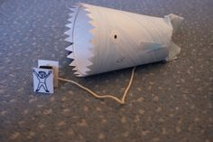jonah and the whale craft - Paper cup, string. The boys would love this! Fun to make, and then they can play with it!