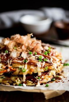 Okonomiyaki - Japanese pancakes made from an easy to make batter, cabbage and bacon topped with Japanese mayo and okonomiyaki sauce.