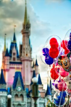 I just love balloon photos. Neat with the castle in the background.