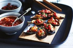 A tasty relish of tomato, spicy chorizo tops fresh mussels.