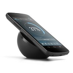 Social Technology - Nexus 4 Wireless Charger with angled surface for easy visibility of your phone while charging. This elegant device was designed specifically for Nexus 4 and is availalble now from Google Play - Chloe Albanesius | PC Mag