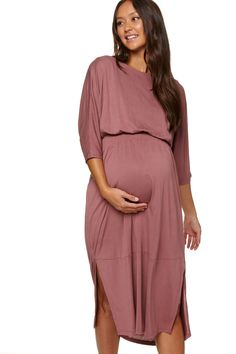 Wewanted aflowy maternity dress that wasn't frumpy...we also thought it should workfor both pregnancy and nursing. The result = a REVERSIBLE dress that weknow you'll love.  Made from our lightweight, super-soft Modal knit. It has a peached finish that we are obsessed with and beautiful drape for a polished look Pregnant Nurse, Pregnant Model, Flowy Maternity Dress, Dress P, Wrap Dress, Batwing Top, Reversible Dress, Baby Shower Dresses, Polished Look