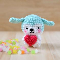 """I """"Ruff"""" U, Tammy the amigurumi puppy is holding a heart to greet you a very Happy Valentine's Day."""