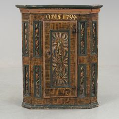 """CORNER CABNET, Sweden, folk art, dated """"OMS 1794"""" -- HÖRNSKÅP, allmoge, daterad 1794. Bemålad. Dörr med bakomliggande hyllplan. Bredd 77,5, djup 43, höjd 96cm. Med monogram O.M.S. Nyckel finns."""