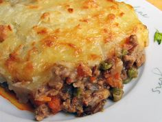 Shepherd's pie is a hearty and delicious casserole of savory ground lamb and vegetables topped with a cheesy potato crust. This versatile British comfort-food classic can be made with any number of ground meats and vegetables.
