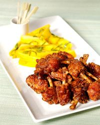 """This delicious recipe is courtesy thai fried chicken wings with sour sauce and salted mango of Jean-Georges Vongerichten and can be found in his cookbook """"Asian Flavors of Jean-Georges. Mango Recipes, Asian Recipes, Ethnic Recipes, Asian Foods, Roasted Chicken Wings, Thai Chicken, Glazed Chicken, Chicken Drumsticks, Chicken Legs"""