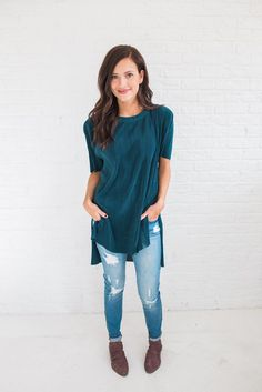 *NO RETURNS ON SALE ITEMS* The most gorgeous dark teal top. Paired with our Arlette Jeans and Free Soul Booties. 100% Polyester Machine wash cold with like colors, do not tumble dry, iron low Model is wearing a size small