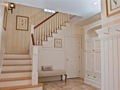 Cottage Staircase with interior wallpaper, slate tile floors, Wall sconce