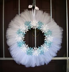 wreath--A little inexpensive white tulle and some Dollar Tree glittery snowflakes and... Voila! Winter wreath!