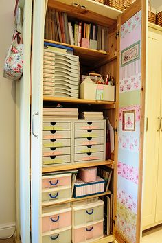 Love this!  Maybe an old armoir would be neat! Or just a tall pantry. But I like the idea of doors to hide the chaos!