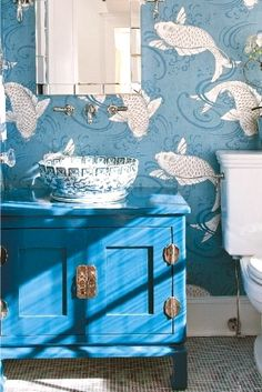 Blue toilet. I love the detailed fish patterns on the wall, they seem dancing in the pond freely. Also, they add a lively movement to the toilet. Beside that, the porcelain sink looks traditional and extraordinary.