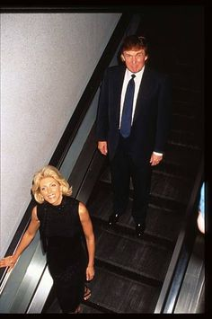 Real estate mogul Donald Trump and wife Marla Maples ride an escalator at the premiere of 'Tin Cup' August 6 1996 in New York City Kevin Costner was...