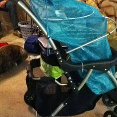 Don't you miss the days you can put all your stuff in the stroller. I bought one for 5 bucks added a mesh laundry bag for 2.50 and an insulated cooler on the back. Perfect for lugging all that stuff to the pool.