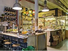 """Woki Organic Market is an ecological market and restaurant in the middle of the city. Just off Plaça de Catalunya, Woki serves """"ecotapas"""" and small plates composed of organically grown ingredients prepared using a variety of healthy techniques and traditions. The sustainability theme continues with the furniture and materials, all made of recycled items, adding to the place an indoor markets atmosphere. Ronda Universitat 20, #barcelona #ecologic #organic #market #woki #healthy #food"""