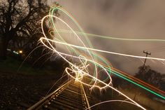 Sparkly drone trail by the railroad tracks in the early morning[2048x1365]